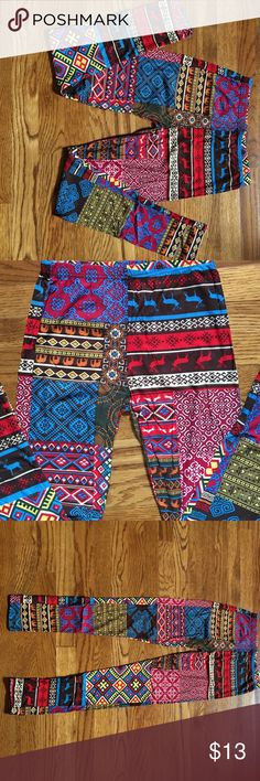 Multi color Leggings.  Red / blue / yellow / brown Multi color Leggings.  Red / blue / yellow / brown. Never been worn.  87% polyester and 12% spandex machine wash cold gentle cycle. Do NOT BLEACH.  Tumble dry on very low heat but I hang mine to just dry on their on.  One size but I would say size 12 or below. LA 12 ST Pants Leggings
