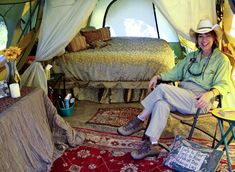 Glamping is upscale camping in which a tent large enough to walk through replaces the pup tent, bedding takes the place of the sleeping bag, a nice rug covers the plastic ground floor, and campers use real barware instead of Dixie cups.