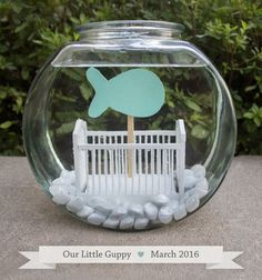 Our pregnancy announcement. We used a fish theme. I made this little set-up which consists of a fishbowl, a tiny dollhouse crib, and a wooden fish cut out.   Full blog post here: https://ittybittywhitty.wordpress.com/2015/09/09/were-having-a-baby-my-baby-and-me/