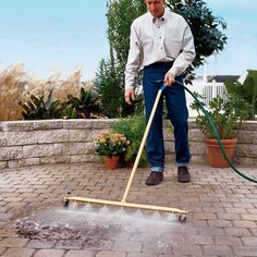 The Wide Expanse Water Broom - This extra wide water broom quickly pressure-sweeps large driveways, poolsides, tennis courts, and other expanses that takes hours to clean using a standard pressure washer or garden hose.