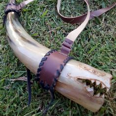 Dragon playing horn and leather holder