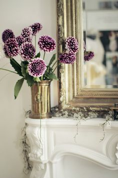 purple flowers on the mantle - perfect touch