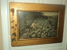 antique 19C print of women working in field of roses, gardening in antique frame with roses on side.For sale starting at $229.00 at AntiqueARTGarden.