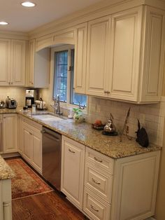 cream subway tile and distressed kitchen cabinets | cream cabinets with Cocoa Glaze NVG Granite white subway tile