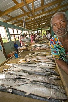 Dangriga, Belize  My neighbor John Jay - best fish cleaner in town