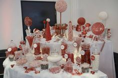 Christmas candy buffet all red and white with handmade candy topiary trees!