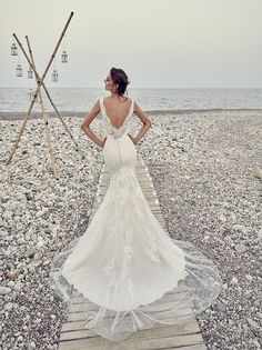 New from the Eddy K. 2017 Dreams collection is Carmen, a wedding dress that is pure elegance. The gorgeous chantilly lace detailing and its tulle overlay on the train make it a gorgeous choice for you