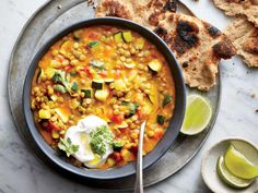 Curried Lentil-and-Vegetable Stew | Cooking Indian dishes at home doesn't have to take hours. Unsalted ketchup is a secret ingredient that adds just the right balance of tomato sweetness and vinegar tang. Serve with lime wedges and toasted naan bread.