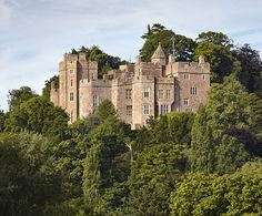 Dunster Castle, Dunster, Somerset, England.... http://www.castlesandmanorhouses.com/photos.htm .... Dunster Castle is a former motte and bailey castle, now a country house. It lies on the top of a steep hill called the Tor, and has been fortified since the late Anglo-Saxon period. In 1976 Colonel Walter Luttrell gave Dunster Castle and most of its contents to the National Trust, which operates it as a tourist attraction. It is a Grade I listed building and scheduled monument.