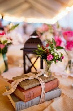 This bundle of old books makes a romantic statement for a wedding or anniversary event. You can find books like these at Safari Thrift in Aurora CO. Book Centerpieces, Wedding Centerpieces, Wedding Decorations, Vintage Book Centerpiece, Book Decorations, Graduation Decorations, Old Books, Vintage Books, Wedding Book