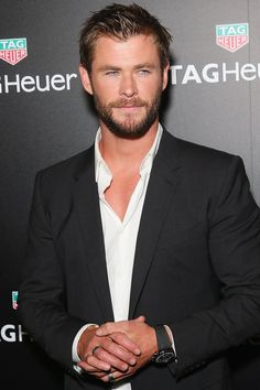 This Clip of Chris Hemsworth Doing Pull-Ups Will Have You More Out of Breath Than He Is