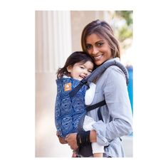 Tula Baby - Ergonomic Carrier - Ripple A sleek design that is bold yet sophisticated proves that parenting can be stylish while functional for your day to day tasks! 'Ripple' displays an interesting line design that repeats against a rich blue color with dark gray canvas. 'Ripple' has a modern pattern and tone that feels refreshingly cool. Is 'Ripple' perfectly suited for you?