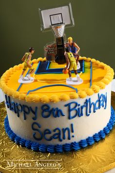 Basketball Court #24Hobbies by Michael Angelo's Bakery | This is a traditional birthday cake iced in buttercream but what makes this cake so special is the topper. They are toy basketball players and hoop that come together in a kit. This kit can be placed on any size cake, even a sheetcake if your occasion calls for more servings.