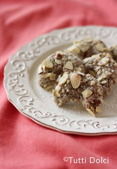 Amaretti (Almond Cookies)   Sub sugar with either splenda or Erythritol and powdered sugar with powdered erythritol