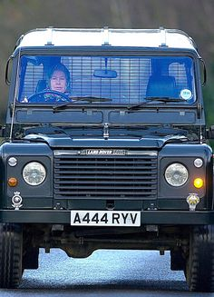 The Queen Behind Wheel Of Her Land Rover On Way To Stables At