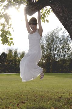 Bridal photo shoot. Playing in a tree. Yup.