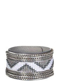 Bracelet en cuir garni de perles de verre, satin et chaîne en métal signé Opale.... Sur www.gsell.fr