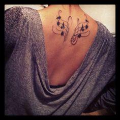 music wings tattoo