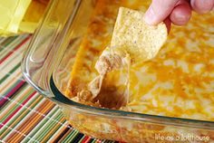 """Texas Trash"" This is SO good, and so easy!! 1 package cream cheese 1 cup sour cream 2 cans (16 ounces, each) refried beans 1 packet taco seasoning 2 cups cheddar cheese, shredded 2 cups monterey jack cheese, shredded - I used a spicy flavor taco mix and used a 4 cup bag of the mexican mix cheese (has cheddar, monterrey jack, & other cheeses that complement well).  :-)"