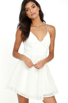 We can't wait to spend the rest of our days in bliss with the Promise Me Forever White Lace Skater Dress! Sheer mesh, with intricate embroidery, tops a stretch knit liner as it shapes a triangle bodice with princess seams. Skater skirt flares below a fitted waist, while adjustable straps crisscross above an open back. Hidden back zipper/hook clasp.