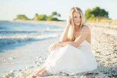 Destination senior pictures in the water on the beach in Tampa