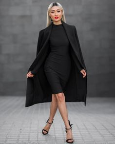 A bodycon dress, long coat, and heels.