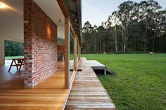 Recycled brick wall acting as a thermal heat bank wall for home