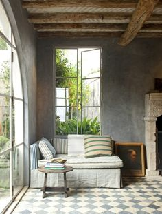 love the beams, fauxed walls, tile floor. calm and inviting