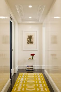 White laquered walls & yellow geometric patterned rug