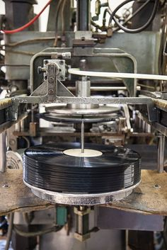 The United Record Pressing factory runs twenty-four hours a day pressing hot vinyl. Photo Credit: Caroline Allison. #nashville #gardenandgun