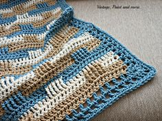 Vintage, Paint and more... an afghan crocheted in a basket weave pattern with beach colors