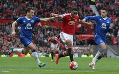 Anthony Martial of Manchester United in action with Leighton Baines and Kevin Mirallas of Everton during the Barclays Premier League match between Manchester United and Everton at Old Trafford on April 3, 2016 in Manchester, England.