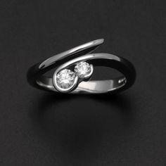18 carat white gold double diamond cross over swirl engagement ring. £1,750.00, via Etsy.
