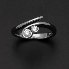 18 carat white gold double diamond cross over swirl engagement ring. £1,750.00, via Etsy.