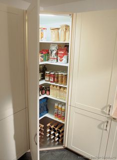 Mini corner pantry photo kitchen-cabinets-modern-two-tone-202-A133b-light-wood-antique-white-corner-pantry-favorite_zps52e7f499.jpg