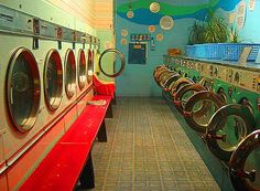 London launderette. I like a launderette afternoon, washing the big duvets and pillows, having a few hours surrounded by soap scents.