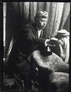 Model posing with a silk hat in Mucha's studio, Rue du Val de Grâce, Paris (c.1896)