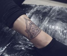 Black and grey ankle tattoo, mandala.