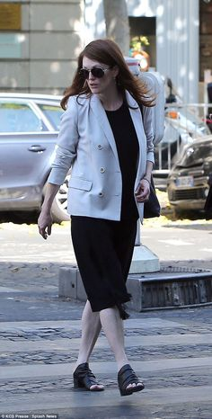 Julianne Moore wore a black leather pair of open toe shoes and kept the sun out of her eyes with a pair of large sunglasses.  She wore a casual T-shirt underneath her smart blazer, as she successfully nailed Parisian chic with her daytime outfit.