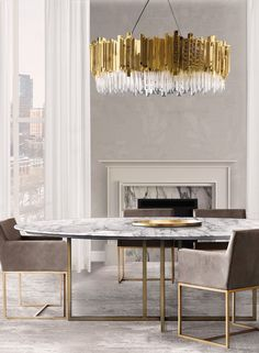 A golden suspension lamp can be the crown jewel to any living room decor! Feel inspired: www.luxxu.net | #luxurydesign #interiordesign #lighting