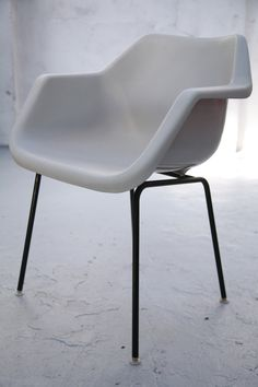 Robin Day; Enameled Metal and Polypropylene Armchair for Hille, 1967.