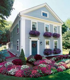 I love the flowers and the color of the house !!!