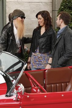 Angela Montenegro: She wore a blue floral top over a pair of jeans, but under a leather motorcycle jacket. Her hair was in loose waves, and she wore braided leather cuffs.