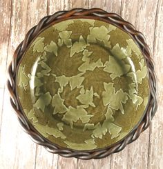 A large ceramic serving bowl from my Fossil Maple Leaves series. Hand built pottery from Botanic2Ceramic.  A wonderful bowl to leave out throughout the year. Looks great as a fruit bowl or with candles or pine cones as the centerpiece of a bountiful family gathering.  Its made with a slab of stoneware clay, slip, real maple leaves and a coiled rim. It was fired, glazed, then fired again in the gas kiln to over 2350 degrees F. Just because I like the bottom to be nice too, its done in my…