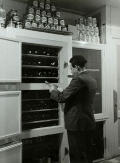 1939. Wine cellar master of the Amstel Hotel in Amsterdam inspects the wine supply. Photo Spaarnestad / Wiel van der Randen. #amsterdam #1940 #amstelhotel
