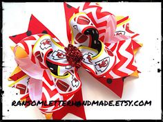 Kansas City Chiefs Hair #Bow in Black Red Red Black and Gold KC #Chiefs ribbon is stacked on top of red #chevron ribbon with gold, red, and black underneath. Has a red glitter center tie by ransomletterhandmade