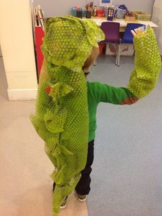 Reception - Bookweek . This is a costume for 'The Enormous Crocodile 'made from bubble wrap. We think this shows amazing creativity .