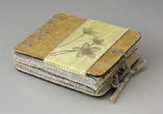 Sometime Sweeter by Sharon McCartney. Mixed media coptic bound book w/printed and embroidered organdy pages.