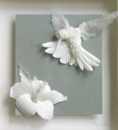 Paper art by papernoodle: http://www.etsy.com/shop/papernoodle