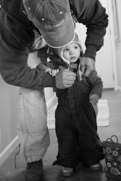 Ranching with Daddy....Everyday process of getting Tate ready @ our household!